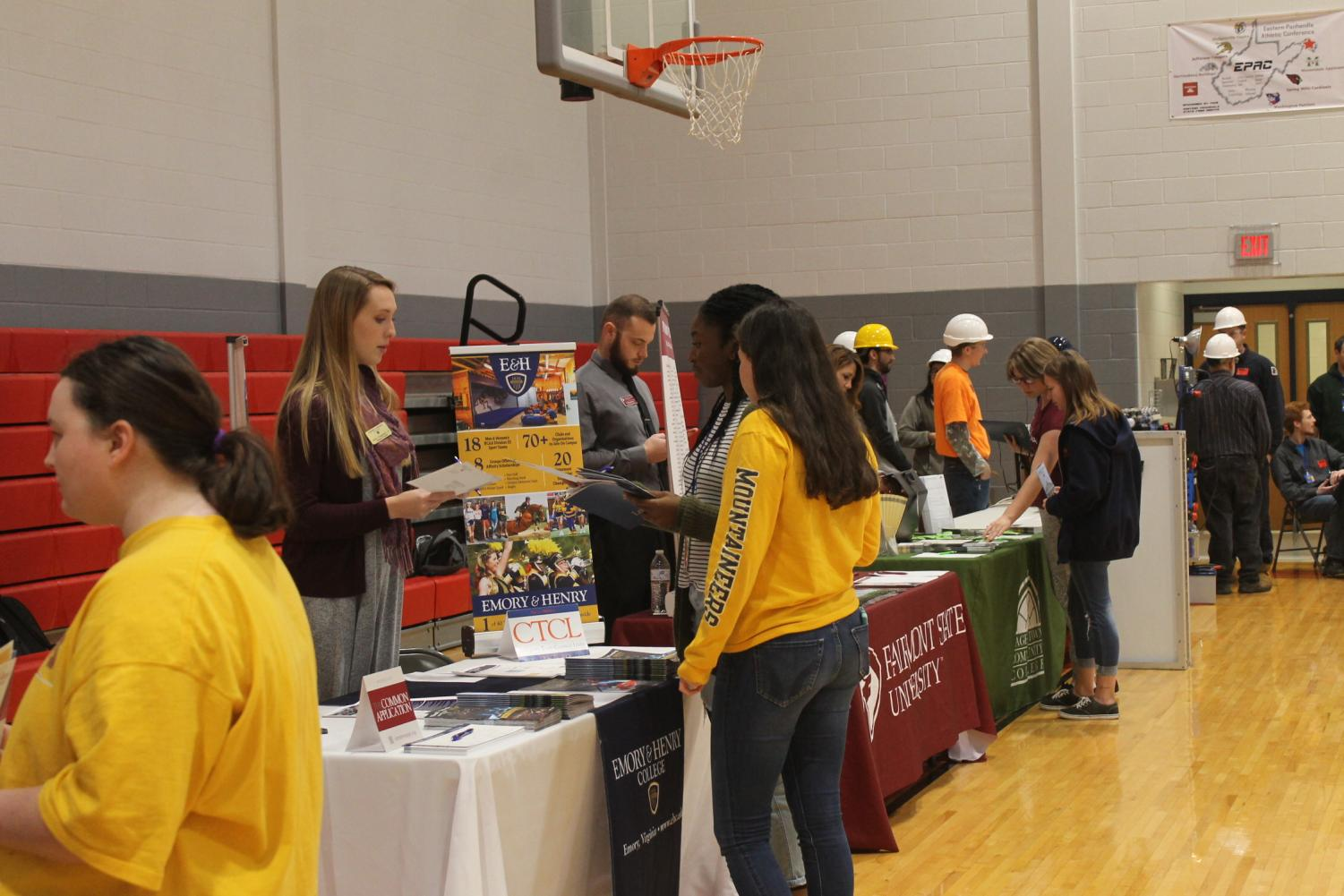 Students learn information about colleges during the College Fair.