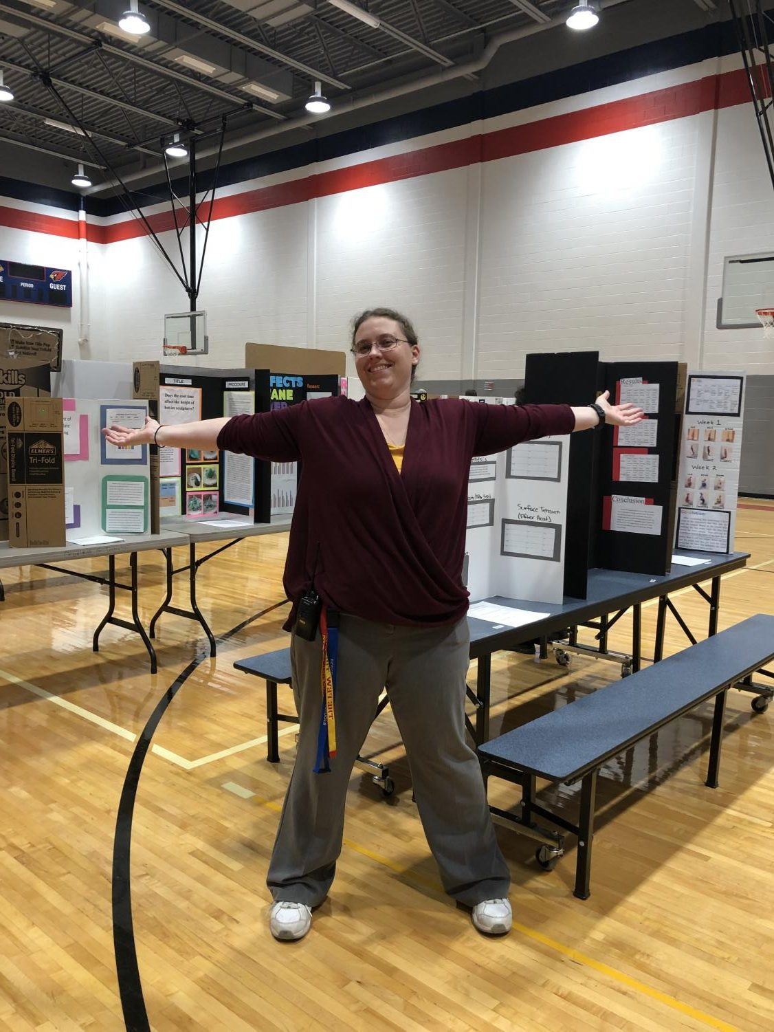 Ms. Woofter showing off her student's projects