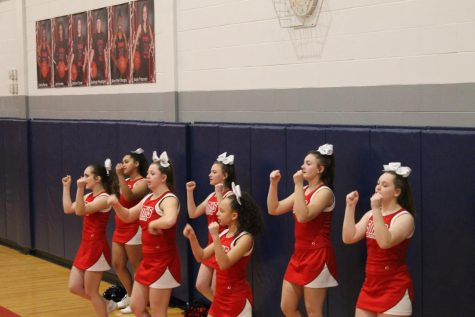 SMHS Varsity Cheerleaders Cheer Their Way to the Basketball Courts
