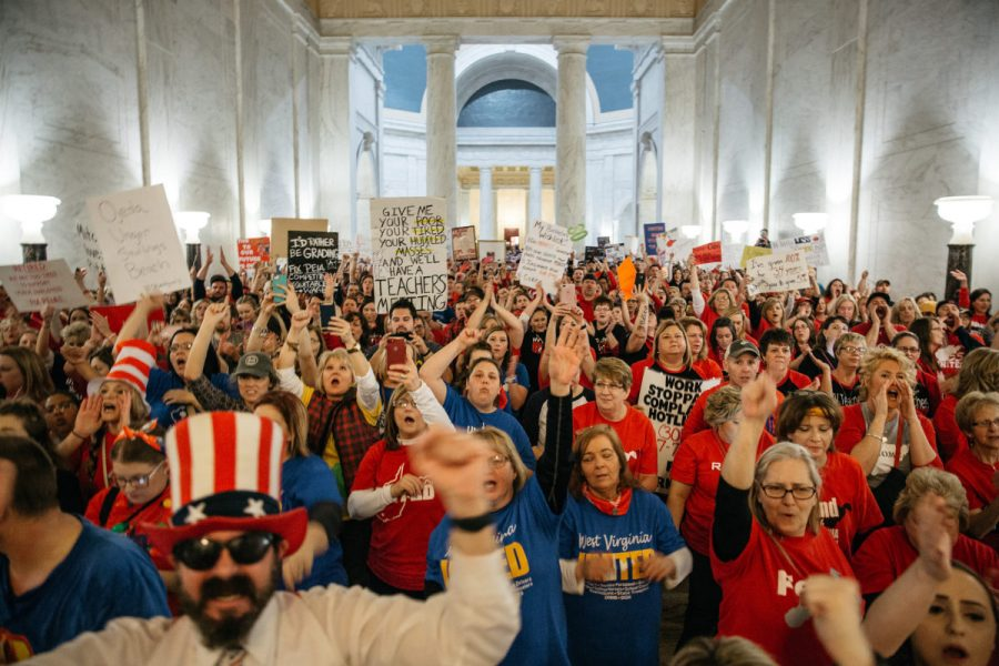 Striking school workers hold signs and chant inside the West Virginia Capitol in Charleston, West Virginia, U.S., on Friday, March 2, 2018. A week ago, thousands of public school teachers in West Virginia went out on strike, a rare but familiar union-organized action to protest low wages and rising health-care costs. Tuesday night, state union leaders and the Governor Jim Justice reached a deal, and the teachers were expected to be back at work on Thursday, but hey didn't go. Unsatisfied with the resolution, they stayed on the picket line, mounting one of the country's biggest unauthorized