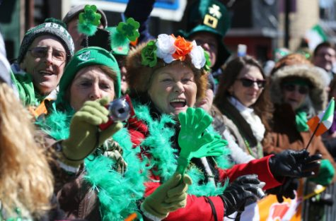 (Boston, MA - 3/18/18) Maria Humphries and Helen Byrne, who came from Ireland for a long weekend, cheer during the St. Patrick